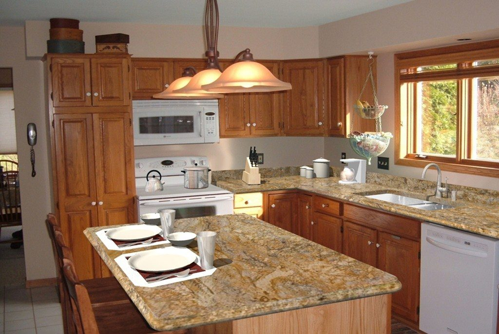 Kitchen granite counter tops home improvement for How to decorate a kitchen counter
